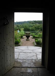 view of the manor garden from the kitchen doorway