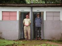 Nash and Skinner emerge from the Kibo campsite toilets