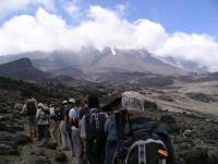 walking across a barren landscape, slowly geting closer to the peak